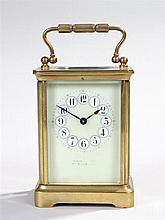 Early 20th Century gilt brass carriage clock, the five glass case with a pa