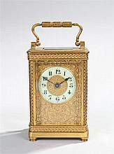 Early 20th Century gilt brass carriage clock, the five glazed case with a c