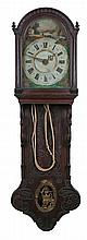 19th Century Dutch wall clock, the arched glazed hood above a carved case,