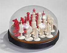 Late 19th Century ivory chess set, the ring turned pieces in red and natura