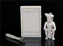 19th Century ivory card case, in the form of a book with carved line decora
