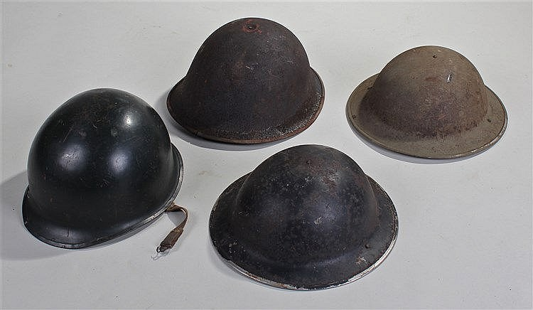 Four helmets, to include a Falklands War period helmet, two home guard helm