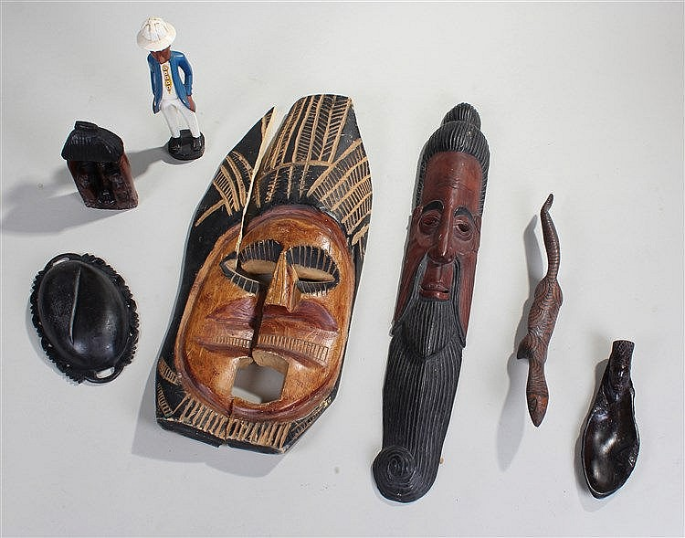 Tribal objects, to include two masks, a painted figure a carved lizard, a b