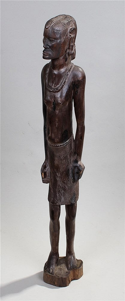 Southern African carved figure, the tall figure with bead necklace, standin