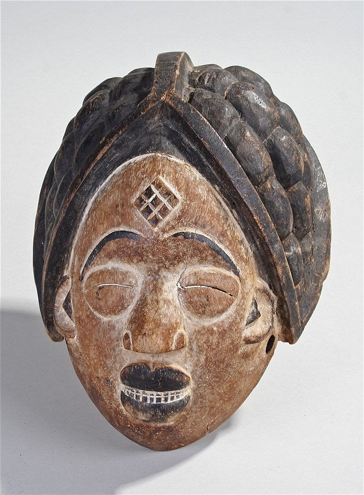 Bapunu mask, the white face with diamond carved brow braided hair, 28cm hig