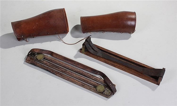 Two game carriers, one with brass hinged locking eyes, together with a pair