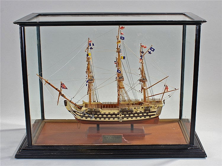 Cased model of H.M.S. Victory, the ship raised on columns  housed within a