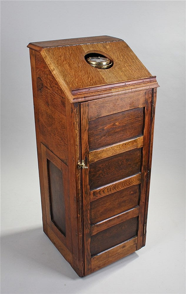Ships binnacle, the oak case with cupboard front housing a compass to the t