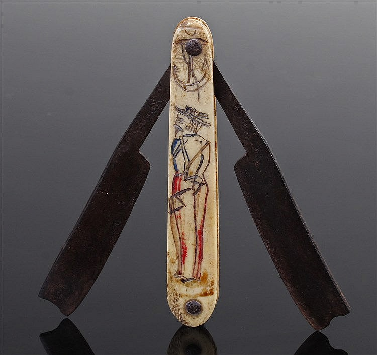 Rare George III sailors scrimshaw razor, the dual blades folding into the c
