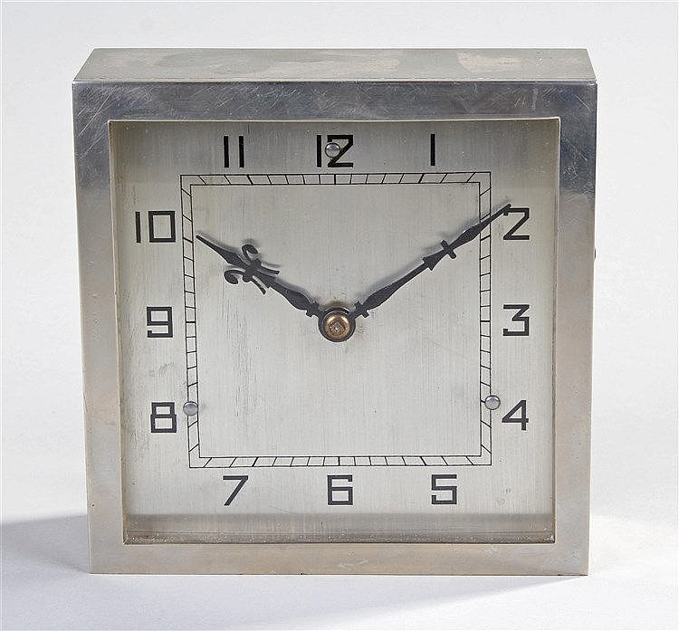 Early 20th Century ships clock, the silvered dial with Arabic hours and squ