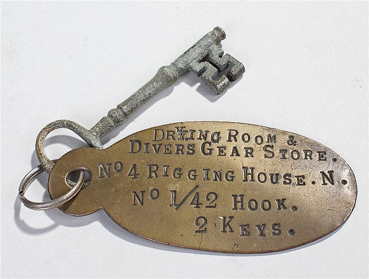 Diving interest, a key attached to a plaque stating