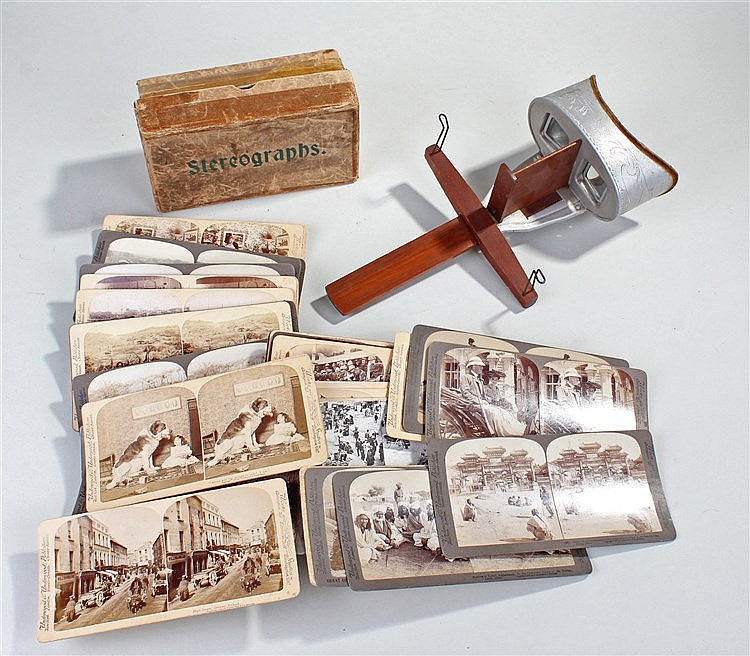 Stereograph viewer and slides, the slides with various scenes to include Bo