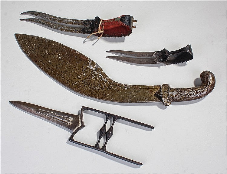 Indian weapons, to include a Katar of typical form, a Kukri with elephants
