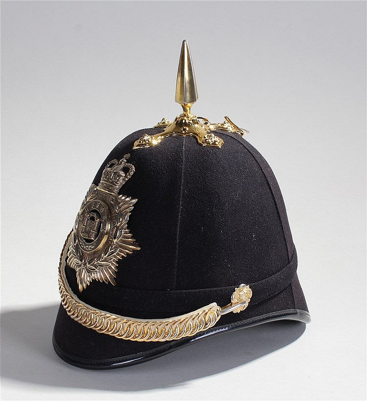 Suffolk Regiment blue British Army cloth helmet, with the Regimental badge