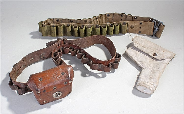 Two bandolier's, the first in leather with a pouch, a canvas example and a