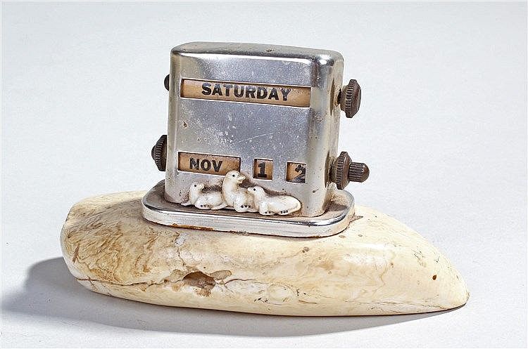 Early 20th Century whales tooth desk calendar, the calendar with swivel day