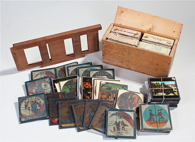 Magic lantern slides, to include boxed Puss in Boots, The Honey-Stealers, A