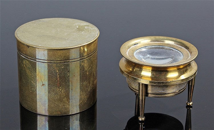 19th Century pocket microscope, raised on three legs, housed within a brass