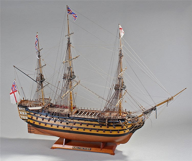 Large model of HMS Victory, sails down, fully rigged, cannons to each side,