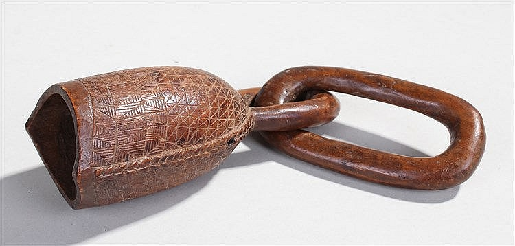 19th Century African carved bell, the chain link above a geometric etched b