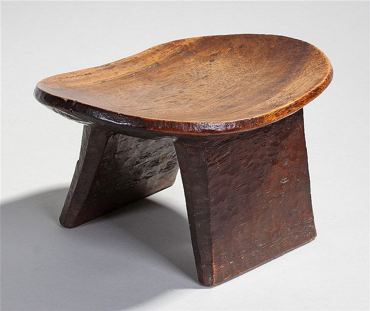 19th Century African stool, the carved out dish top with rectangular suppor