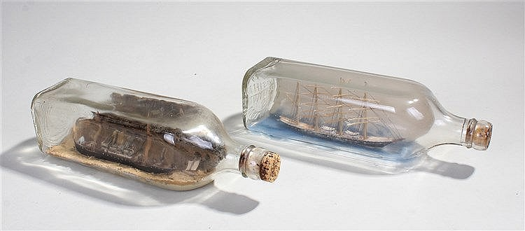 Two early 20th Century ships in bottles, to include a four masted ship and