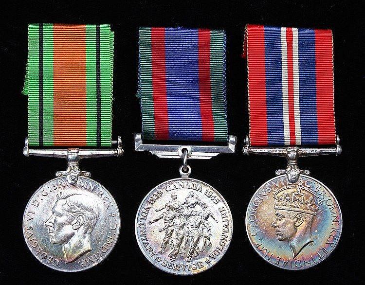 War World II Canadian Volunteer Service Medal, together with Defence and Wa