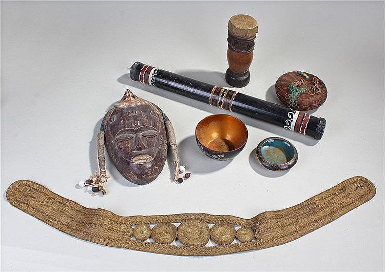 Collection of tribal items, to include an African mask, a basket with glass