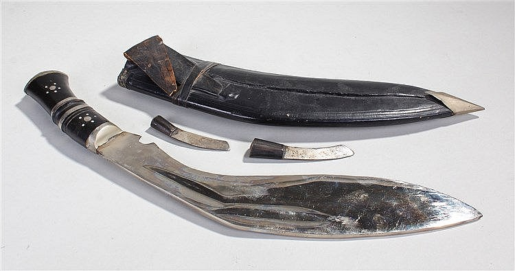 Kukri Nepalese knife, of typical form, two further blades and a leather she