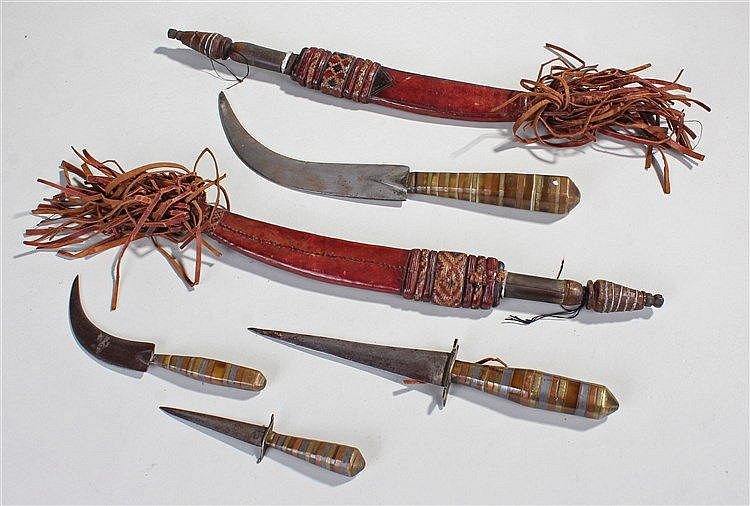 Eastern daggers, to include a set of three mixed metal knives and a pair of