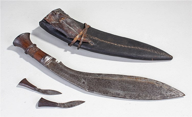 Nepalese Kukri, the carved handle with steel blade, leather scabbard and a
