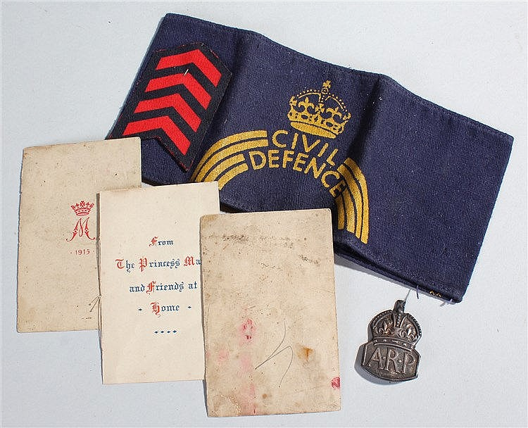 Mixed militaria, to include a Christmas tin, a Civil Defence band, and an A