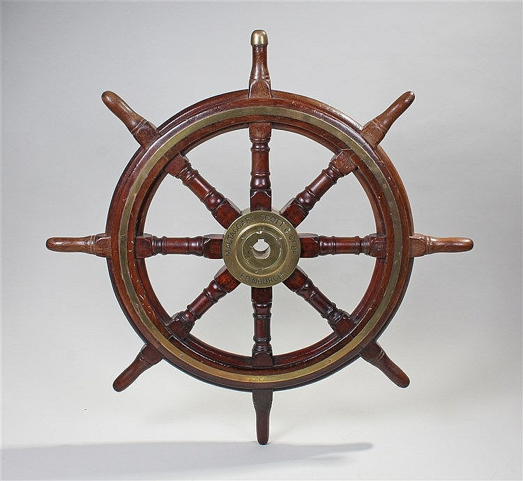 A teak, brass mounted ship's wheel, with eight turned spokes and the centra