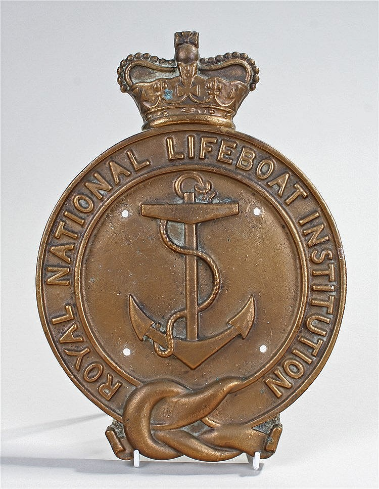 Royal National Lifeboat Institution badge, the brass badge with the anchor