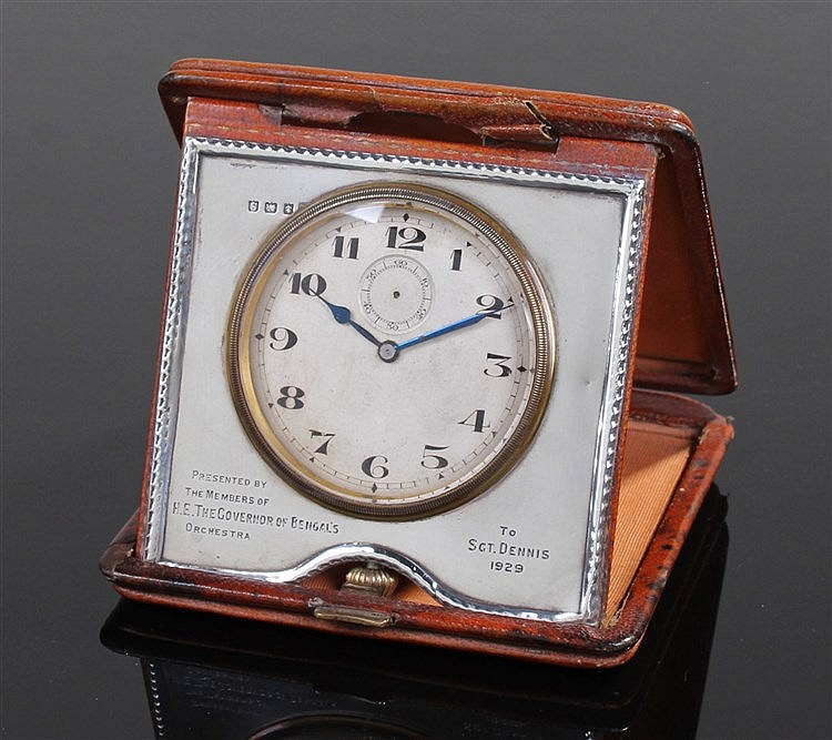 Bengal Orchestra interest, a silver timepiece with the engraved text 'Prese