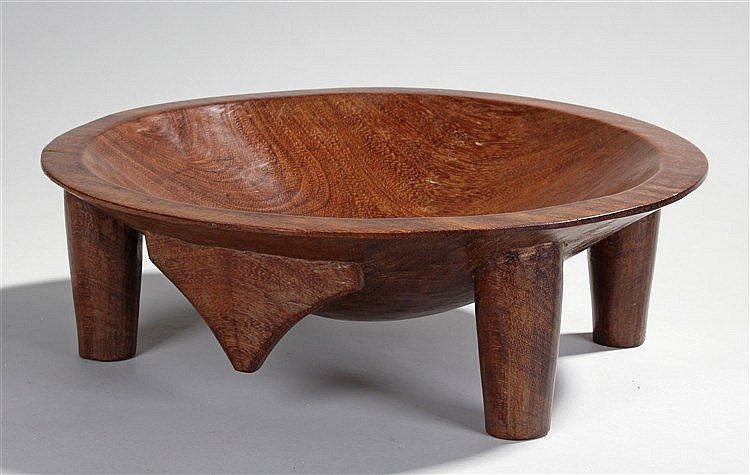 Fijian kava bowl, the hollowed dish above tapering supports, 40cm wide, 13c