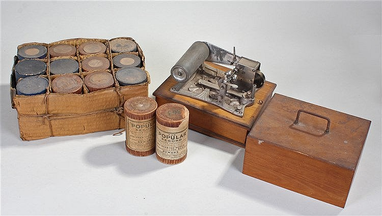 German Phonograph, the phonograph raised on a pine box, together with fourt