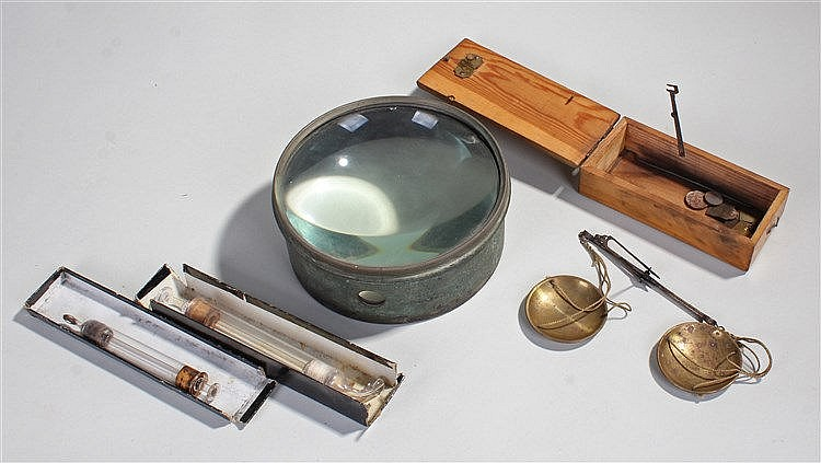 Apothecary scales, with brass pans and steel arm, together with a lens and