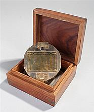 Brass compass, the hinged case enclosing the compass, housed within a ancho