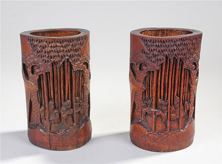 Pair of Japanese bamboo brush pots, each carved with a figure below tall tr