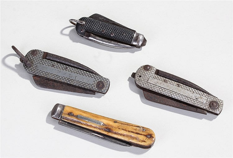 Military penknives, to include two examples with a spike, a blade, another
