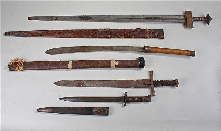 Four edged weapons, to include a Sudanese sword with sun and moon blade, a