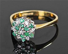 18 carat gold diamond and emerald ring, in the for