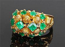 Asprey 18 carat gold and emerald ring, the raised