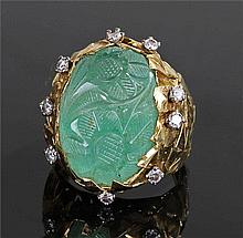 Unusual carved emerald and diamond set ring, the e