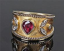18 carat gold diamond and ruby ring, the pear cut
