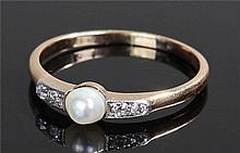 Diamond and pearl ring, the central pearl flanked
