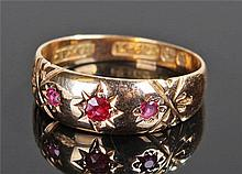 15 carat gold ruby ring, with three rubies on a ta