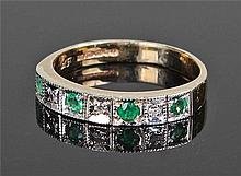 9 carat gold emerald and diamond ring, set with fo