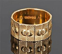 22 carat gold band, of wide proportions, decorated with angled panels with